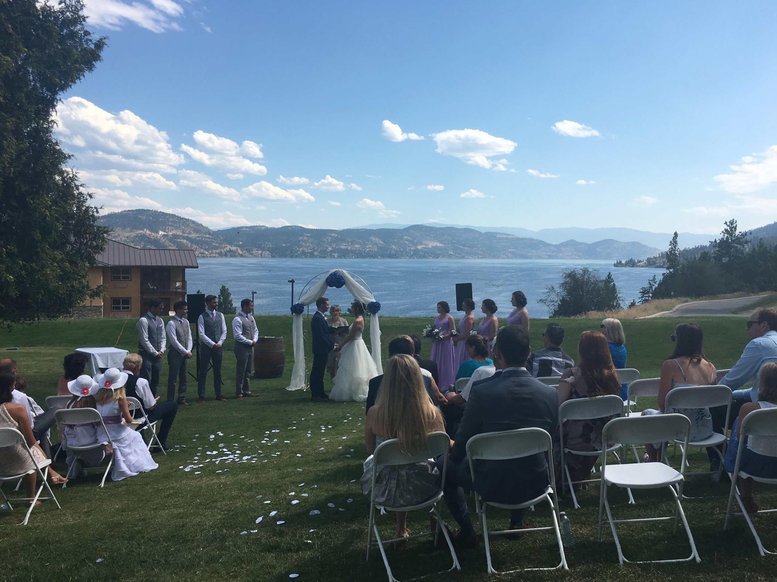 People Gathered For Wedding Ceremony On Vitner's Golf Course