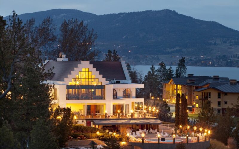 Night Time View Of Okanagan Beach Club With Lights And Lake In Background