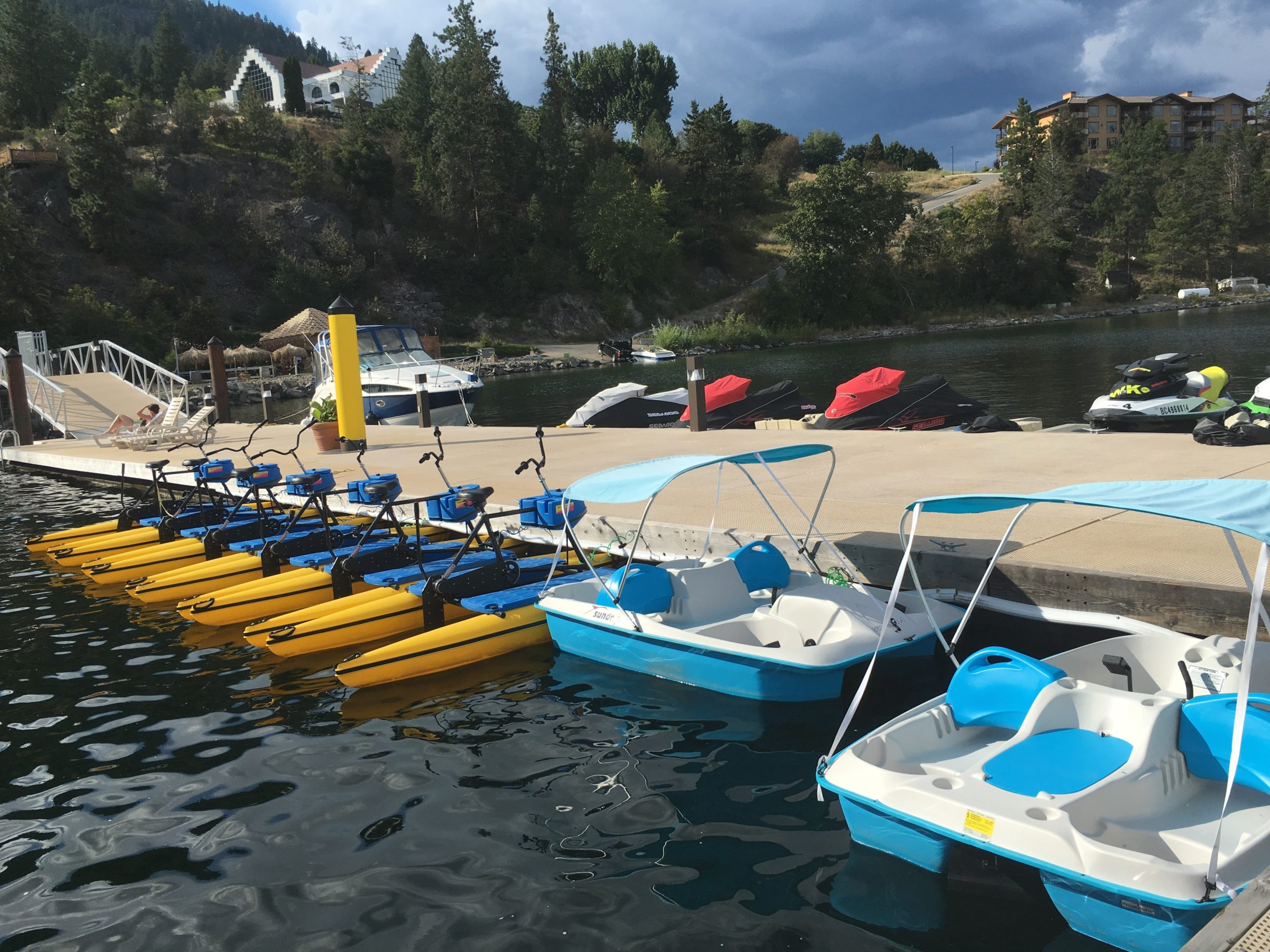 Paddle Boats And Jet Skis On The OBC Dock Located On Okanagan Lake